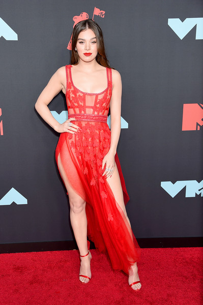 Hailee Steinfeld looked red-hot in a sheer corset dress by Aadnevik at the 2019 MTV VMAs.