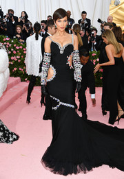 Bella Hadid looked opulent in a gemstone-embellished cutout gown by Moschino at the 2019 Met Gala.