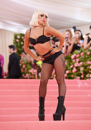 She completed her look with a Lady Gaga signature: platform lace-up boots, which even came fully beaded to match her undies.