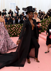 Danai Gurira's flowing coat and plunging jumpsuit combo at the 2019 Met Gala was a super-sexy take on menswear.