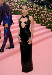 Zoe Kravitz went the racy route in a black Saint Laurent column dress with a provocative heart-shaped cutout at the 2019 Met Gala.