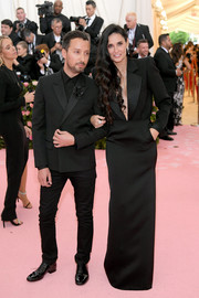 Demi Moore looked simply elegant in a black tuxedo gown by Saint Laurent at the 2019 Met Gala.