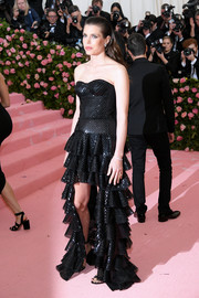 Charlotte Casiraghi was edgy-glam in a strapless black Saint Laurent gown with a high-low hem at the 2019 Met Gala.