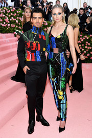 Sophie Turner rocked a graphic Louis Vuitton jumpsuit at the 2019 Met Gala.