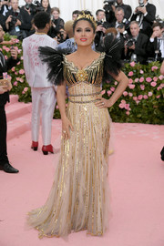 Salma Hayek looked fantastic in a gold and black sequined gown by Gucci at the 2019 Met Gala.