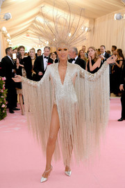 Celine Dion matched her bodysuit with silver T-strap pumps by Chloe Gosselin.