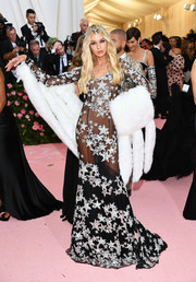 Stella Maxwell looked sultry in a sheer, star-embellished gown by Moschino at the 2019 Met Gala.