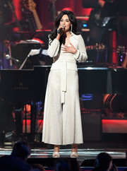 Kacey Musgraves wore a belted white knit top while performing at the 2019 MusiCares Person of the Year event.