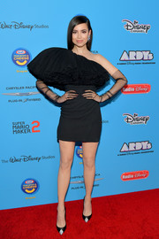 Sofia Carson styled her look with a pair of bedazzled pumps, also by Saint Laurent.