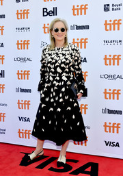 A black leather clutch by Valentino sealed off Meryl Streep's attire.