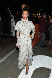 A pair of silver ankle-strap pumps by Rupert Sanderson polished off Gugu Mbatha-Raw's ensemble.
