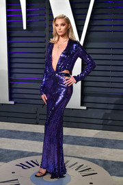 Elsa Hosk was a knockout in a purple sequined cutout gown by Tom Ford at the 2019 Vanity Fair Oscar party.
