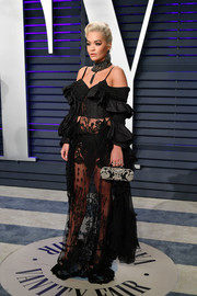 Rita Ora finished off her look with an embroidered clutch, also by Alexander McQueen.