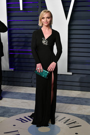Christina Ricci gave her black dress a splash of color with an emerald-green clutch by Edie Parker.