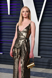 Sophie Turner went for high shine with this gold purse and dress combo at the 2019 Vanity Fair Oscar party.