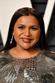 Mindy Kaling prettied up her eyes with a swipe of sapphire shadow.