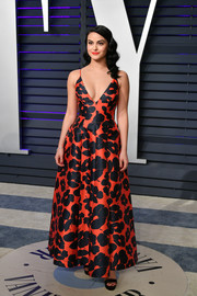 Camila Mendes was spring-glam in an orange and black floral gown by Lela Rose at the 2019 Vanity Fair Oscar party.
