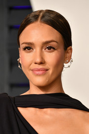 Jessica Alba went for a simple center-parted chignon at the 2019 Vanity Fair Oscar party.