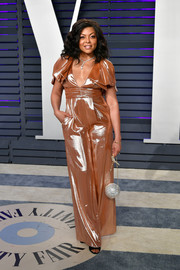 Taraji P. Henson shimmered in a copper jumpsuit by Roland Mouret at the 2019 Vanity Fair Oscar party.