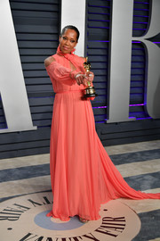 Regina King looked sweet in a coral cold-shoulder gown by Monique Lhuillier at the 2019 Vanity Fair Oscar party.