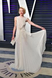 Jaime King chose a pleated white Schiaparelli Couture gown with gold beading for the 2019 Vanity Fair Oscar party.