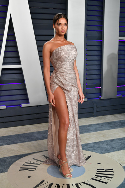 Shanina Shaik flashed her leg in a high-slit strapless gown by Maison Yeya at the 2019 Vanity Fair Oscar party.