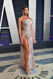 Shanina Shaik complemented her dress with strappy gold heels by Casadei.
