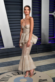 Emily Ratajkowski wowed in a strapless Brock Collection corset dress with a peplum waist and a mermaid hem at the 2019 Vanity Fair Oscar party.