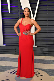 Tracee Ellis Ross rocked a red one-shoulder gown by Versace at the 2019 Vanity Fair Oscar party.
