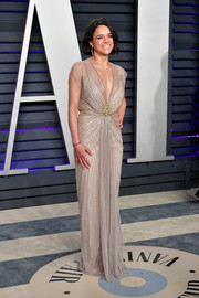 Michelle Rodriguez looked divine in a beaded taupe gown by Jenny Packham at the 2019 Vanity Fair Oscar party.