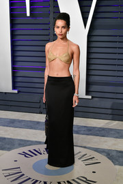 Zoe Kravitz paired her bra with a black maxi skirt by Saint Laurent.