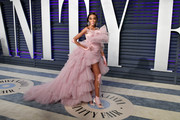 Winnie Harlow was hard to miss in this voluminous pink fishtail dress by Monsoori at the 2019 Vanity Fair Oscar party.