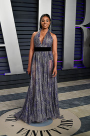 Regina Hall chose a sexy purple halter gown by Georges Chakra Couture for the 2019 Vanity Fair Oscar party.