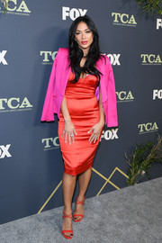 Nicole Scherzinger went for a striking color pairing with this fuchsia blazer and red dress combo.