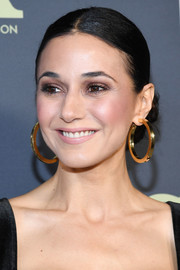 Emmanuelle Chriqui wore her hair in a center-parted chignon at the 2019 Fox Winter TCA Tour.