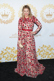 Jodie Sweetin paired her beautiful dress with a crescent-shaped python clutch by Annie Handbags.