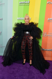 Christina Aguilera owned the purple carpet in a sequined jumpsuit with a ruffled bodice and train at the 2019 amfAR Gala Los Angeles.