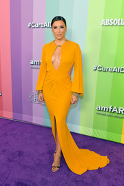 Eva Longoria ravished in a cleavage-baring cutout gown by Dundas at the 2019 amfAR Gala Los Angeles.