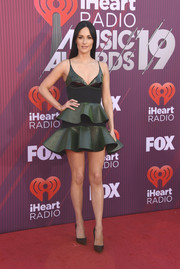 Kacey Musgraves went flirty in a tiered green mini dress by David Koma at the 2019 iHeartRadio Music Awards.