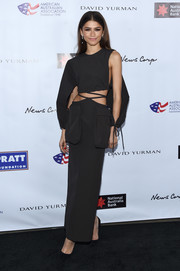 Zendaya Coleman looked modern and sexy in a black Christopher Esber gown with a midriff cutout at the 2020 AAA Arts Awards.