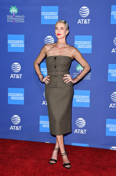 Charlize Theron paired her top with a matching pencil skirt.