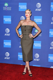 Charlize Theron attended the 2020 Palm Springs International Film Festival Awards wearing a strapless micro-houndstooth bustier over a fishnet top.