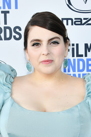 Beanie Feldstein punctuated her blues with pink lipstick.