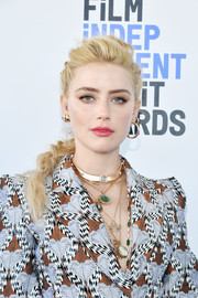 Amber Heard finished off her look with a ton of gemstone necklaces.