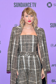 Taylor Swift attended the 2020 Sundance Film Festival wearing a plaid bustier top by Carmen March with a matching coat and pants.