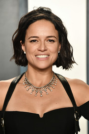 Michelle Rodriguez wore her hair in a short wavy style at the 2020 Vanity Fair Oscar party.