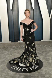 Natalie Dormer looked regal in an off-the-shoulder floral gown by Vivienne Westwood Couture at the 2020 Vanity Fair Oscar party.