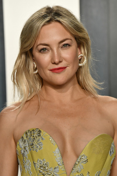 Kate Hudson rounded out her glamorous look with a pair of diamond hoops by David Webb.
