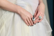 Lucy Boynton rocked a pair of statement rings by Boucheron at the 2020 Vanity Fair Oscar party.