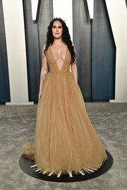 Rumer Willis attended the 2020 Vanity Fair Oscar party wearing a plunging nude tulle gown with subtle gold beading.